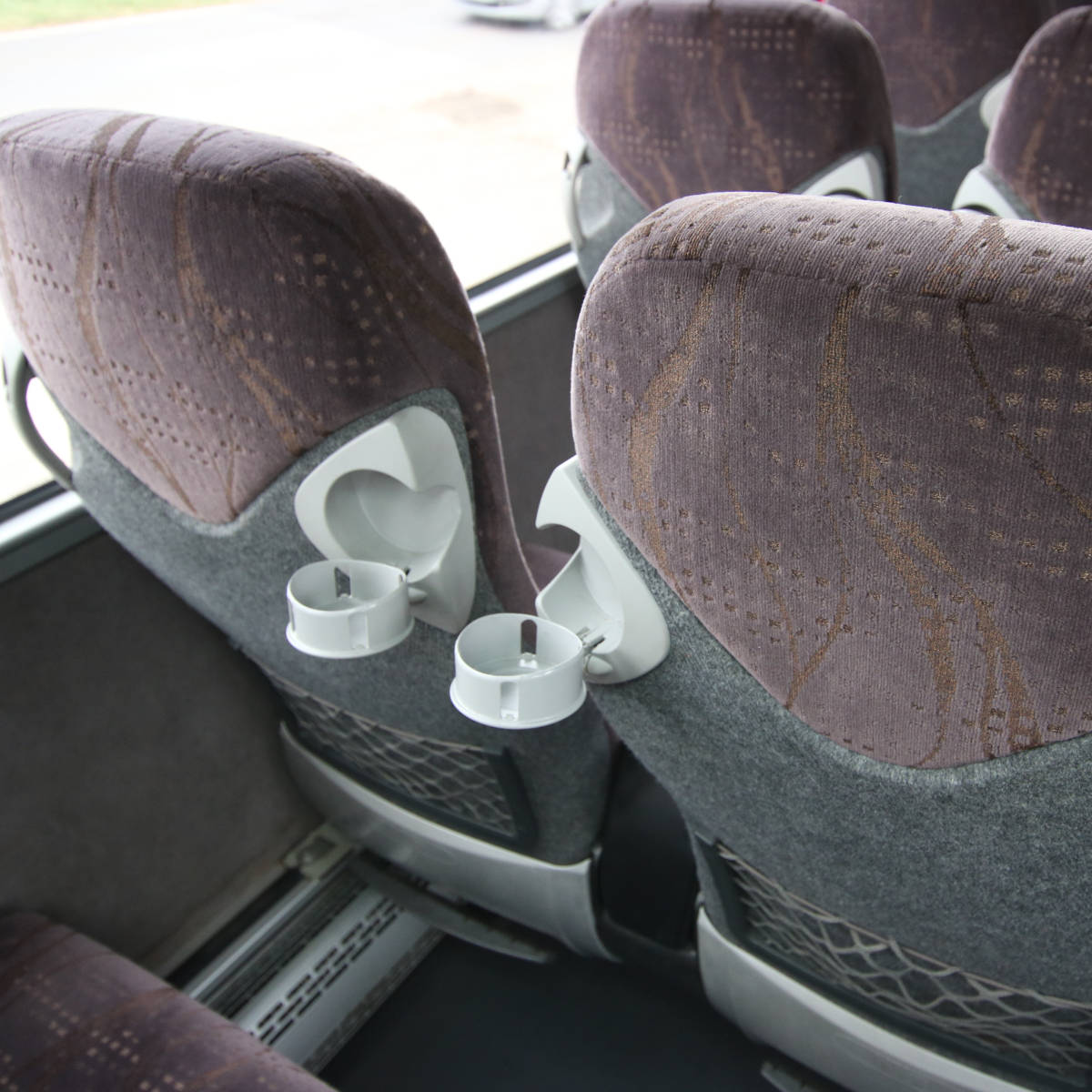 Image of 53 Seat Luxury Coach, Cup Holders Detail